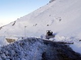 A bulldozer clears the Lowari Top road of snow. The road is the only land route connecting Chitral to other parts of the country. PHOTO: INP