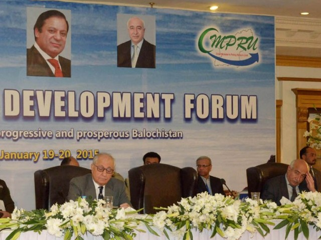 Balochistan Chief Minister Abdul Malik Baloch (R) at the Balochistan Development Forum in Islamabad on Monday. PHOTO: PID