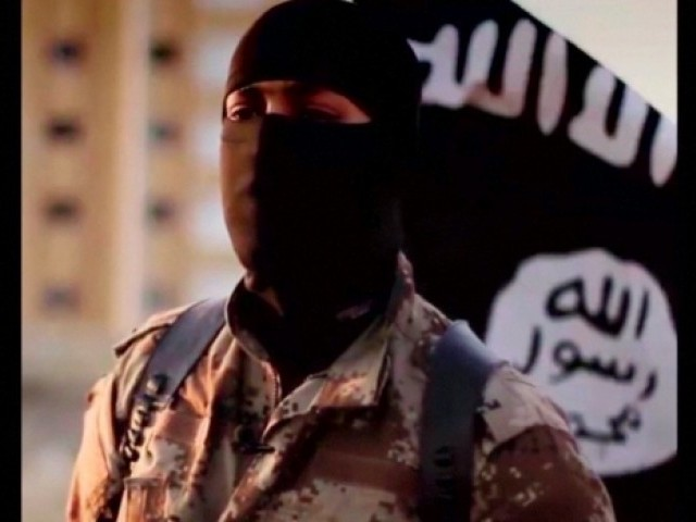 A masked man speaking is shown in a video released by IS militants in September 2014. PHOTO: REUTERS