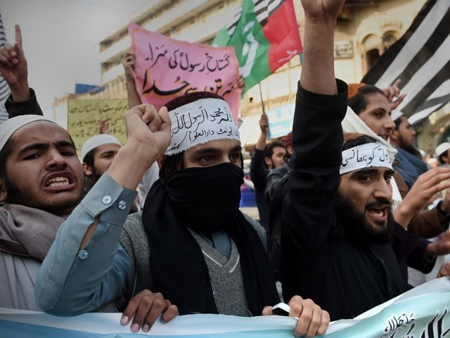 Activists from different Pakistani religious parties shout slogans against the printing of satirical sketches of the Prophet Mohammed by French magazine Charlie Hebdo, in Peshawar. PHOTO: AFP
