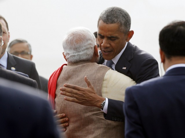 U.S. President Barack Obama hugs India's Prime Minister Narenda Modi as he arrives at Air Force Station Palam in New Delhi January 25, 2015. PHOTO: REUTERS