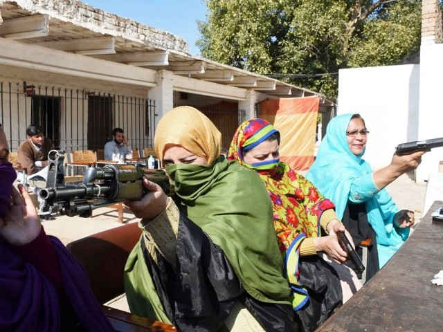 Teachers handle various firearms during a weapons training session for school, college and university teachers at a police training centre in Peshawar on January 27, 2015.  PHOTO: AFP
