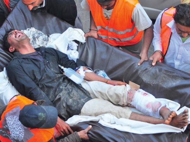 At least 57 killed in blast at Imambargah; province-wide strike today. PHOTO: PPI