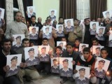relatives-of-islamic-state-captive-jordanian-pilot-muath-al-kasaesbeh-hold-his-portrait-as-they-take-part-in-a-rally-in-his-support-at-the-familys-headquarters-in-the-city-of-karak-2