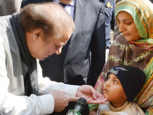 PM Nawaz speaks to a child at G-10 market on Sunday, February 8, 2015. PHOTO: INP