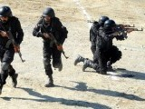 Policemen perform drills during a training module at a police training centre in Nowshera,Khyber Pakhtunkhwa. PHOTO: AFP