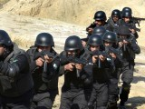 Police officers armed with sub-machine guns march in formation as part of a special elite training course at the police training centre in Nowshera, Khyber Pakhtunkhwa on February 11, 2015. PHOTO: AFP