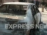 Express News screengrab of a vehicle that was destroyed in the blast that took place in Peshawar.