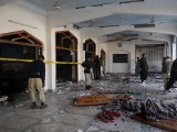 Security personnel inspect the Shia mosque after an attack by Taliban militants in Peshawar on February 13, 2015. PHOTO: AFP