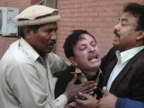 A man cries over the death of his relative, who was killed in an explosion in a Shia mosque, outside a hospital in Peshawar on February 13, 2015. PHOTO: REUTERS