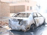 A destroyed car is seen at the blast site in Hayatabad, Peshawar following an attack on a Shia mosque on Friday, February 13, 2015. PHOTO: MUHAMMAD IQBAL/EXPRESS