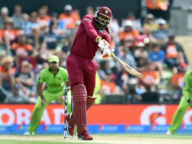 West Indies batsman Chris Gayle (C) hits out against the Pakistan bowling during their 2015 Cricket World Cup Group B match in Christchurch on February 21, 2015. PHOTO: AFP