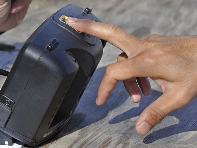 As many as 70,000 biometric machines have been installed at sale points of cellular mobile operators.  PHOTO: AFP