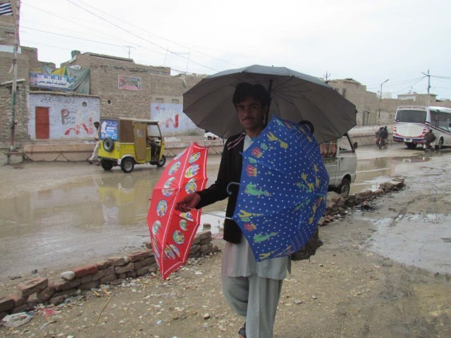 A man in sukkur sells umbrellas after a rainfall in the city on Sunday, March 1, 2015. PHOTO: NAEEM AHMED GHOURI/EXPRESS