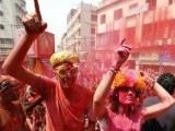 Foreign tourists daubed in colours dance as they celebrate Holi in the northeastern Indian city of Guwahat. PHOTO: REUTERS