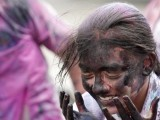 A schoolgirl reacts after being smeared with color during celebrations of Holi, also known as the festival of colors, outside their school in the western Indian city of Ahmedabad. PHOTO: REUTERS