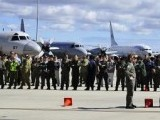International and Australian air crews involved in search for missing Malaysia Airlines plane MH370, prepare for official photograph on tarmac at the RAAF Pearce Base in Bullsbrook, near Perth. PHOTO: REUTERS