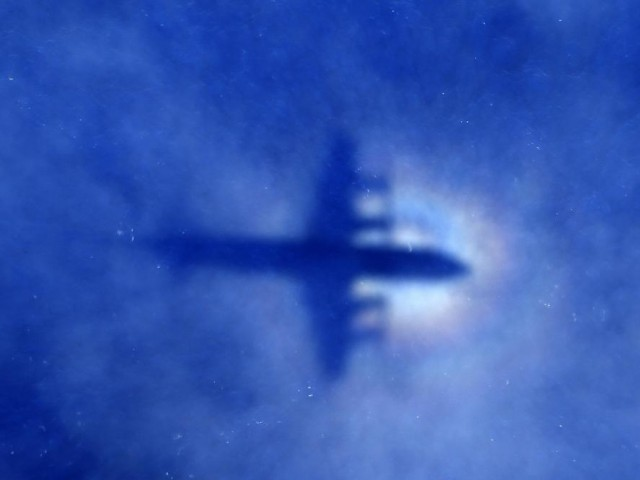 The shadow of a Royal New Zealand Air Force (RNZAF) P3 Orion maritime search aircraft can be seen on low-level clouds as it flies over the southern Indian Ocean looking for missing Malaysian Airlines flight MH370. PHOTO: REUTERS