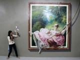 Reuters / Friday, March 06, 2015 A student pose in front of a 3D painting during class field trip at the Art In Island Museum in Quezon City, metro Manila. PHOTO: REUTERS