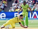 Australia's paceman Mitchell Johnson drops a possible catch of Pakistan's batsman Wahab Riaz (not pictured) as Shahid Afridi (R) looks on during the 2015 Cricket World Cup quarter-final match between Pakistan and Australia at the Adelaide Oval on March 20, 2015. PHOTO: AFP