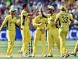 Australia's paceman Mitchell Starc (C) celebrates his wicket of Pakistan's batsman Wahab Riaz (not pictured) with teammates during the 2015 Cricket World Cup quarter-final match between Pakistan and Australia at the Adelaide Oval on March 20, 2015. PHOTO: AFP