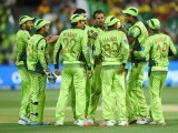 Pakistani cricketers celebrate after the wicket of Australian captain Michael Clarke during the 2015 Cricket World Cup quarter-final match between Australia and Pakistan in Adelaide on March 20, 2015. PHOTO: AFP