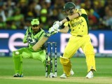 Wicket-keeper Sarfraz Ahmed (L) looks on as Australian batsman Steve Smith plays a shot during the 2015 Cricket World Cup quarter-final match between Australia and Pakistan in Adelaide on March 20, 2015. PHOTO: AFP