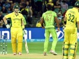 Australia's batsman Shane Watson (L) exchanges words with paceman Wahab Riaz (C) during the 2015 Cricket World Cup quarter-final match between Pakistan and Australia at the Adelaide Oval on March 20, 2015. PHOTO: AFP
