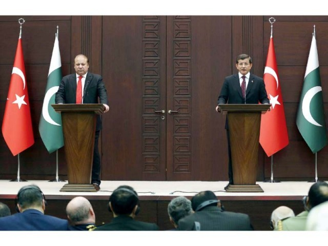 Prime Minister Nawaz Sharif (L) and his Turkish counterpart Ahmet Davutoglu hold a joint press conference at the Cankaya Palace in Ankara. PHOTO: AFP