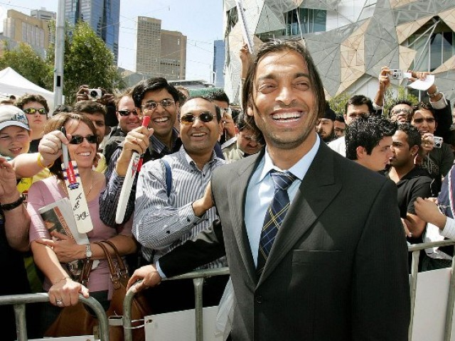 A file photo of Shoaib Akhtar smiling with his fans. PHOTO: AFP