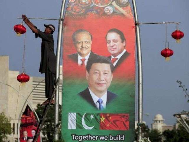 Beijing, Islamabad sign 50-plus agreements worth $28 billion. PHOTO: REUTERS