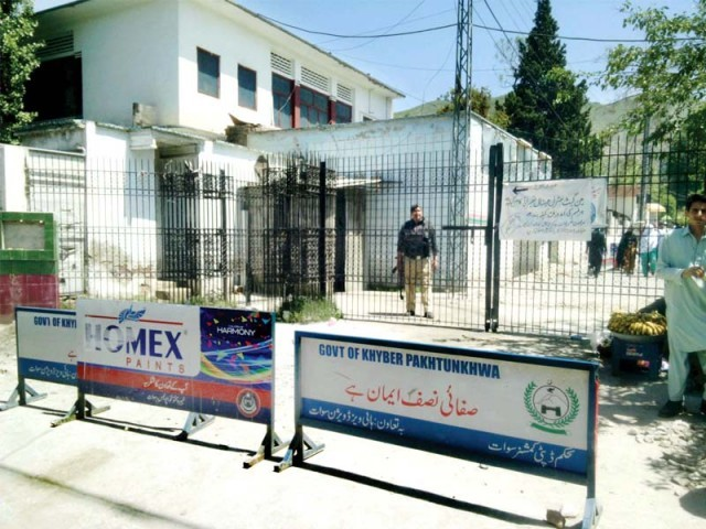 Gate of Saidu Teaching Hospital is closed due to construction work. PHOTO: FAZAL KHALIQ/EXPRESS