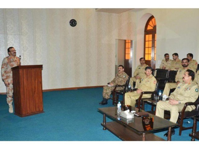 Army chief Gen Raheel Sharif receiving a briefing by the Corps HQ in Karachi from DG Rangers on operation preparedness and latest law and order situation. PHOTO: ISPR