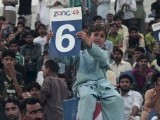 A child among the enthusiastic crowd reacts after a long hit across the boundary. PHOTO MALIK SHAFIQ/EXPRESS