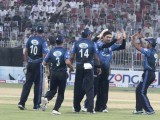 Dolphins seen jubilant after another crucial wicket in the all-important tussle. PHOTO MALIK SHAFIQ/EXPRESS