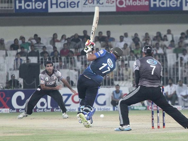 Eyes on the ball: Dolphins batsman hits hard to ensure it crosses the boundary. PHOTO MALIK SHAFIQ/EXPRESS