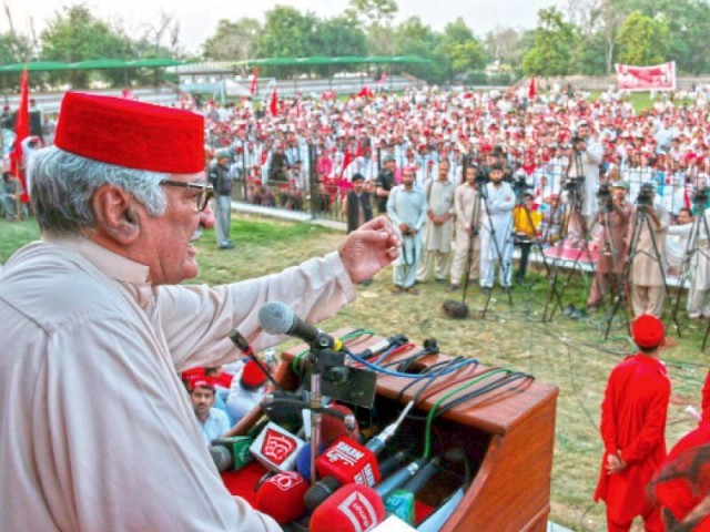 ANP's Asfandyar Wali addresses a rally in Tehmash Khan Stadium. PHOTO: MUHAMMAD IQBAL/ EXPRESS