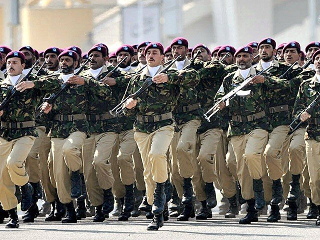 Soldiers of Special Services Group march past during a ceremony of Pakistan National Day. PHOTO: APP