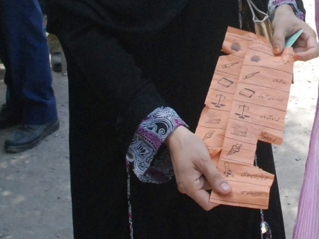A voter in Charsadda shows a torn ballot paper. PHOTO: SAMEER RAZIQ/EXPRESS
