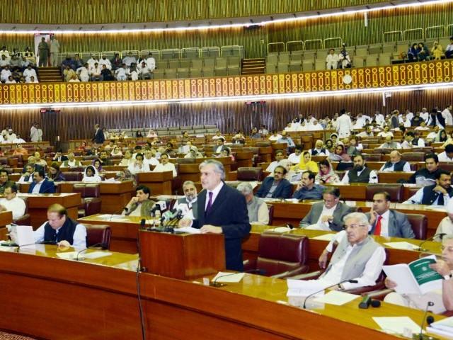 Finance Minister Ishaq Dar presenting the budget in the National Assembly on Friday. PHOTO: PID