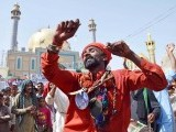 A devotee during dhamaal at the shrine of Lal Shahbaz Qalandar in Sehwan during the 763rd Urs. PHOTO: INP