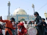 Devotees dance to the sound of drums during the 763rd Urs of Lal Shahbaz Qalandar in Sehwan. PHOTO: APP
