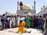 Devotees perform during a dhamaal outside the shrine of Lal Shahbaz Qalandar in Sehwan during the 763rd Urs. PHOTO: INP