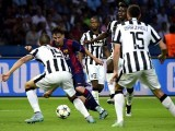 Barcelona's Argentinian forward Lionel Messi (2nd L) and Juventus' players vie for the ball during the UEFA Champions League Final football match between Juventus and FC Barcelona at the Olympic Stadium in Berlin on June 6, 2015. PHOTO: AFP
