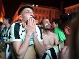Juventus' supporters react as they watch the UEFA Champions League Final football match between Juventus and FC Barcelona on June 6, 2015 in Piazza San Carlo in Turin. PHOTO: AFP