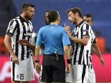 Juventus' Swiss defender Stephan Lichtsteiner (L) discusses with Turkish referee Cuneyt Cakir (C) during the UEFA Champions League Final football match between Juventus and FC Barcelona at the Olympic Stadium in Berlin on June 6, 2015. PHOTO: AFP