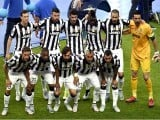 Juventus team ready right before the match, posing for a team photo at UEFA Champions League Final football match. PHOTO: AFP