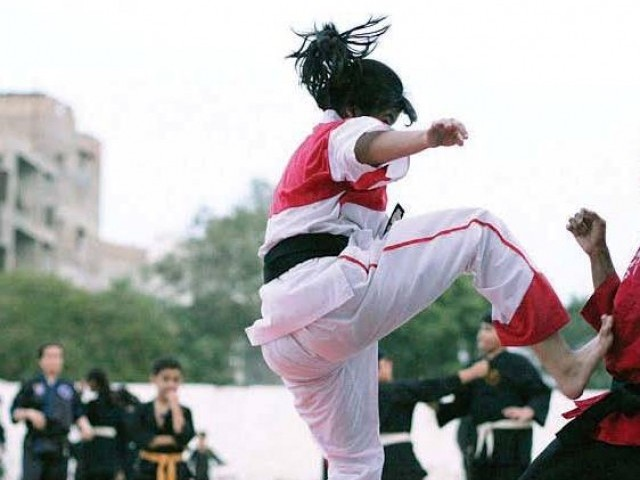Pakistan's martial artist successfully created three new Guinness records at the Pakistan Academy of Martial Arts on Sunday. PHOTO: EXPRESS