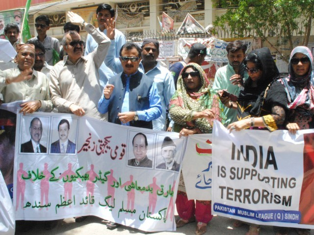 Political parties took to the streets in protest of India's 'terrorist activities' within Pakistan. PHOTO: SHAHID ALI/EXPRESS