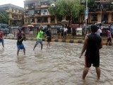 Indian youth play a game of volleyball in a waterlogged street in Mumbai on June 19, 2015. Heavy monsoon showers lashed India's financial capital resulting in waterlogging in low lying areas of the city disrupting normal life. PHOTO: AFP